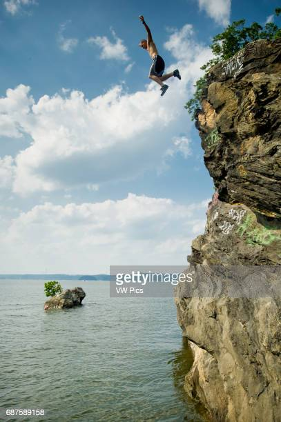 Cliff diver falling into the water in Maryland near Mason Dixon line