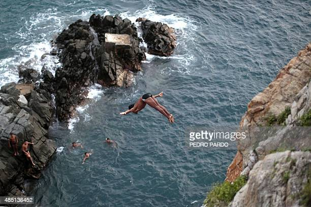 A cliff diver jumps at La Quebrada in Acapulco Mexico on August 14 2015 The tradition of 'La Quebrada' goes back to 1934 when two neighbors of...