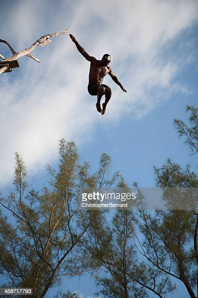 cliff diving - black men in speedos stock photos and pictures