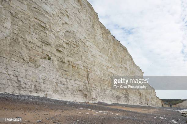 cliff face of the seven sisters chalk cliffs, east sussex, uk - steep stock pictures, royalty-free photos & images