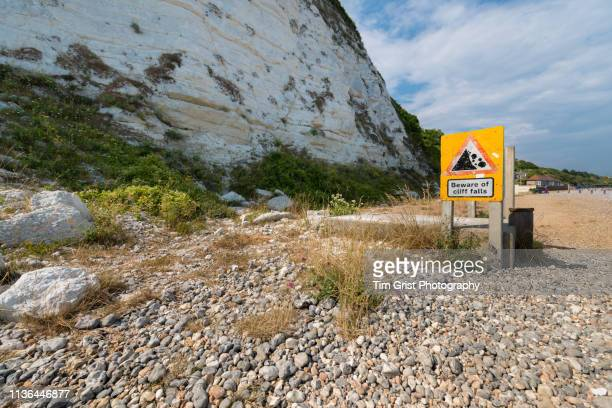 cliff fall sign, beachy head, eastbourne, east sussex, uk. - chert stock photos and pictures