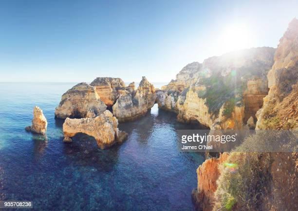 cliff formations of ponta da piedade, algarve, portugal - lagos portugal stock photos and pictures