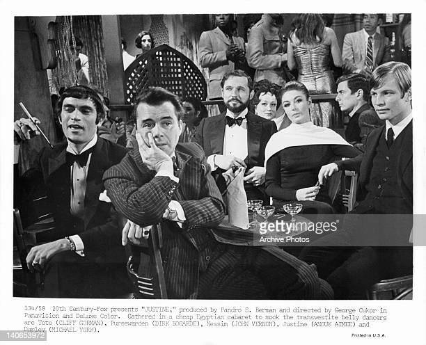 Cliff Gorman Dirk Bogarde John Vernon Anouk Aimee and Michael York are gathered to mock the transvestite belly dancers in a scene from the film...