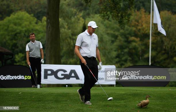 Cliff Gough of Hindhead Golf Club removes a duck from the 10th tee, as Ben Clayton of Hindhead Golf Club looks on during day two of the PGA Fourball...