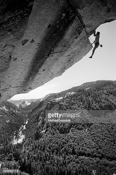 cliff hanger - rock overhang stock pictures, royalty-free photos & images