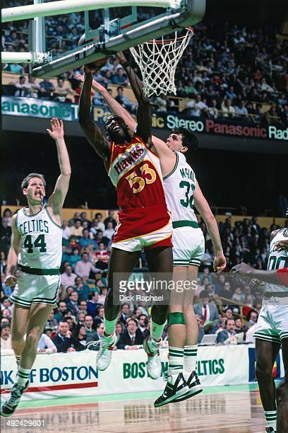 Cliff Levingston of the Atlanta Hawks shoots againest Kevin McHale of the Boston Celtics during a game played in 1988 at the Boston Garden in Boston...