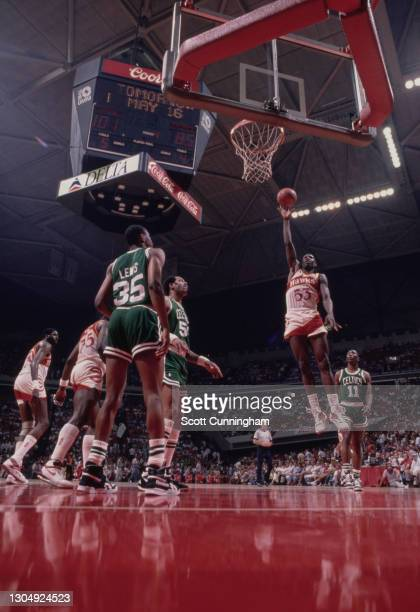 Cliff Levingston, Power Forward for the Atlanta Hawks makes a one handed lay up shot to the basket during the NBA Central Division basketball game...