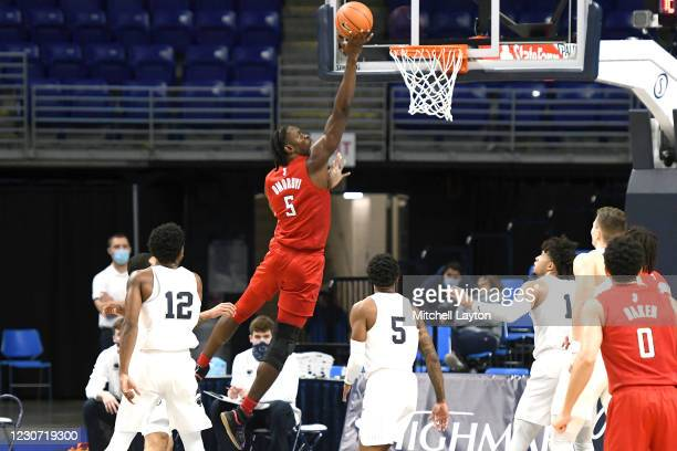 Cliff Omoruyi of the Rutgers Scarlet Knights drives to the basket in the first half a college basketball game against the Penn State Nittany Lions on...