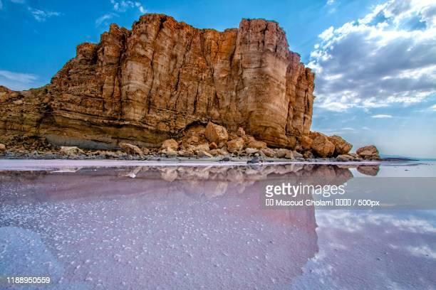 cliff on shore of lake urmia, iran - lake urmia foto e immagini stock