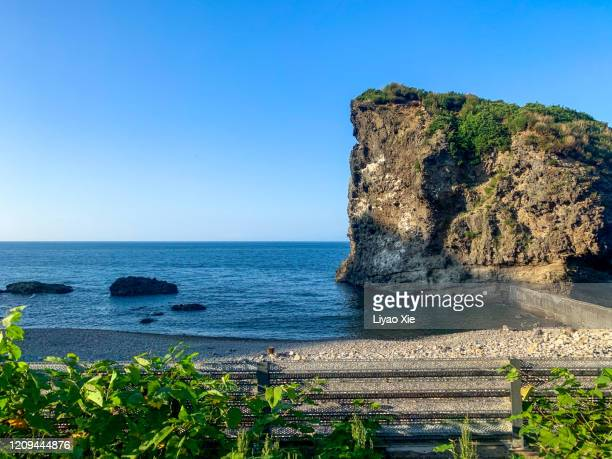cliff on the seaside - liyao xie stock pictures, royalty-free photos & images