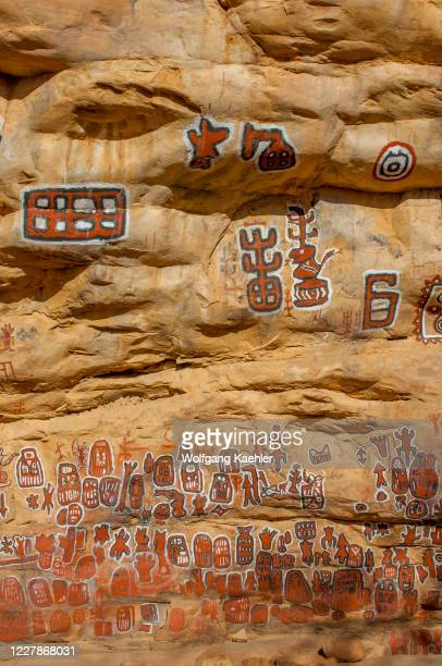Cliff painted with images that reflect the moment of the circumcision of boys at the Dogon village of Songho in the Bandiagara Escarpment in the...