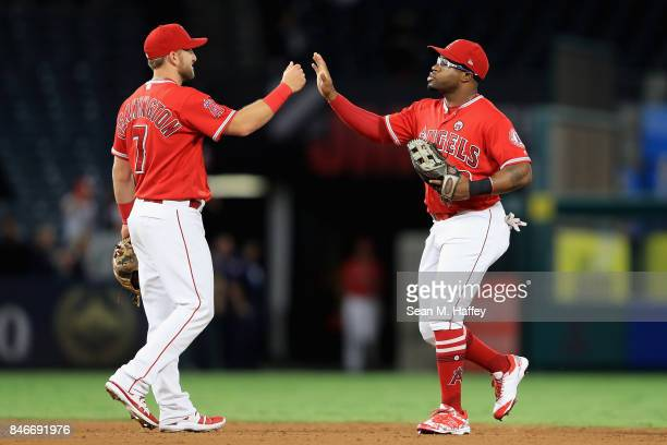 Cliff Pennington and Eric Young Jr #8 of the Los Angeles Angels of Anaheim celebrate defeating the Houston Astros 91 in a game at Angel Stadium of...