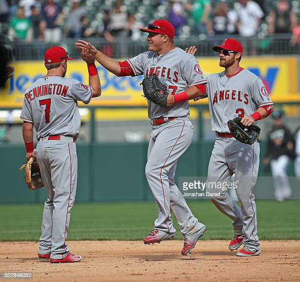Cliff Pennington Mike Trout and Craig Gentry of the Los Angeles Angels celebrate a win over the Chicago White Sox at US Cellular Field on April 21...