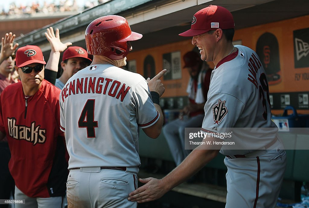Cliff Pennington #4 of the Arizona Diamondbacks is congratulated by Will Harris #38 after Pennington scored against the San Francisco Giants in the top of the six inning at AT&T Park on September 11, 2014 in San Francisco, California.