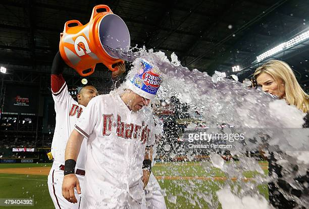 Cliff Pennington of the Arizona Diamondbacks is dunked with gatorade by Yasmany Tomas after Pennington hit a walkoff sacrifice fly to defeate the...