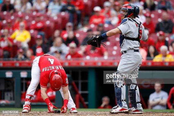 Cliff Pennington of the Cincinnati Reds reacts after striking out with the bases loaded in the ninth inning of the game against the St Louis...