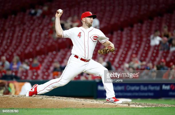Cliff Pennington of the Cincinnati Reds throws a pitch in the ninth inning against the St Louis Cardinals at Great American Ball Park on April 12...