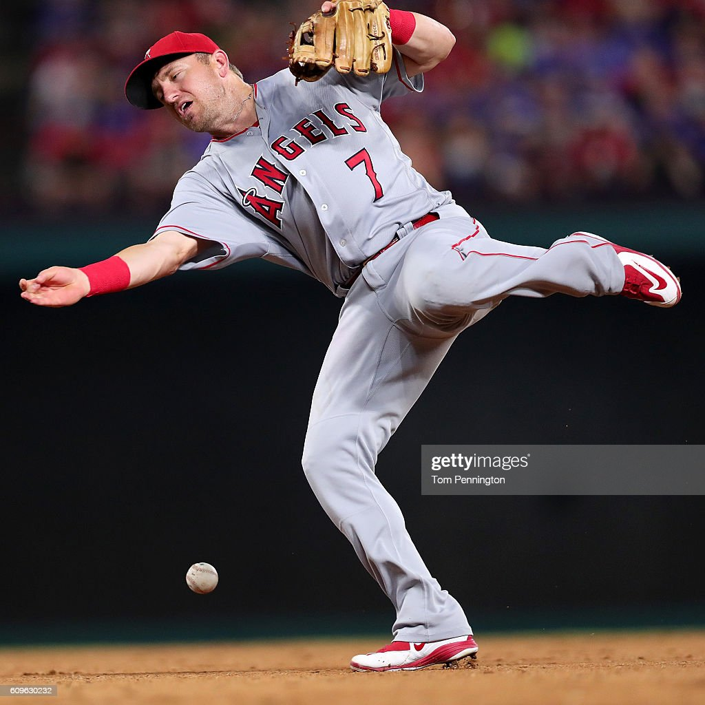 Cliff Pennington #7 of the Los Angeles Angels bobbles a ground ball hit by Carlos Beltran #36 of the Texas Rangers in the bottom of the eighth inning at Globe Life Park in Arlington on September 21, 2016 in Arlington, Texas.