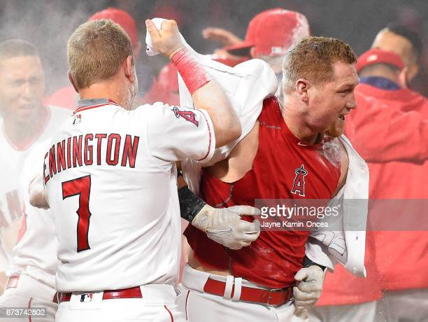 Cliff Pennington of the Los Angeles Angels celebrates with Kole Calhoun as he gets douced with powder after he singled in the game winning run in the...
