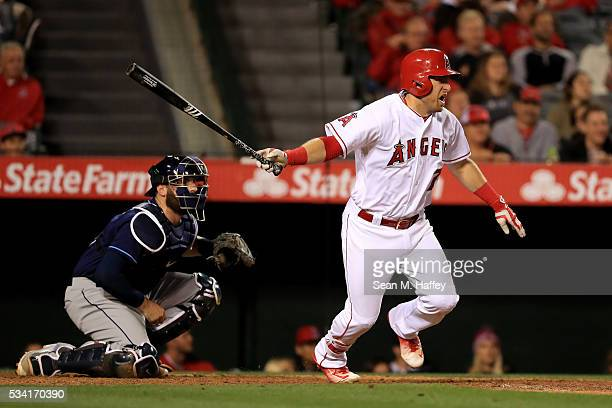 Cliff Pennington of the Los Angeles Angels of Anaheim follows through on a hit as Curt Casali of the Tampa Bay Rays looks onduring a baseball game...
