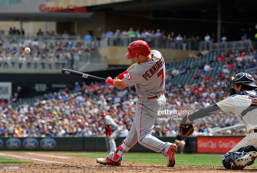 Cliff Pennington #7 of the Los Angeles Angels of Anaheim hits a two-run double against the Minnesota Twins as John Ryan Murphy #12 of the Minnesota Twins catches during the second inning of the game on April 16, 2016 at Target Field in Minneapolis, Minnesota.