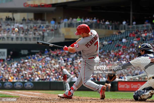 Cliff Pennington of the Los Angeles Angels of Anaheim hits a tworun double against the Minnesota Twins as John Ryan Murphy of the Minnesota Twins...