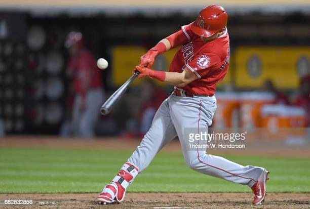 Cliff Pennington of the Los Angeles Angels of Anaheim hits an rbi single scoring Cameron Maybin against the Oakland Athletics in the top of the...
