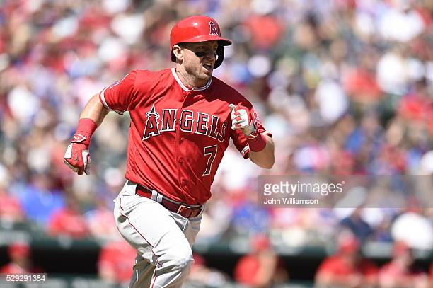 Cliff Pennington of the Los Angeles Angels of Anaheim runs to first base after hitting the ball in the game against the Texas Rangers at Globe Life...