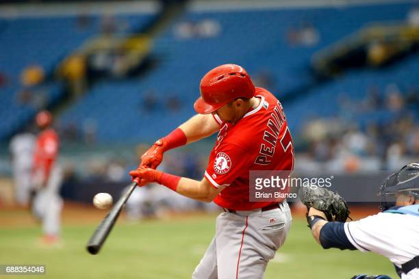 Cliff Pennington of the Los Angeles Angels of Anaheim strikes out swinging in front of catcher Jesus Sucre of the Tampa Bay Rays with two men on base...