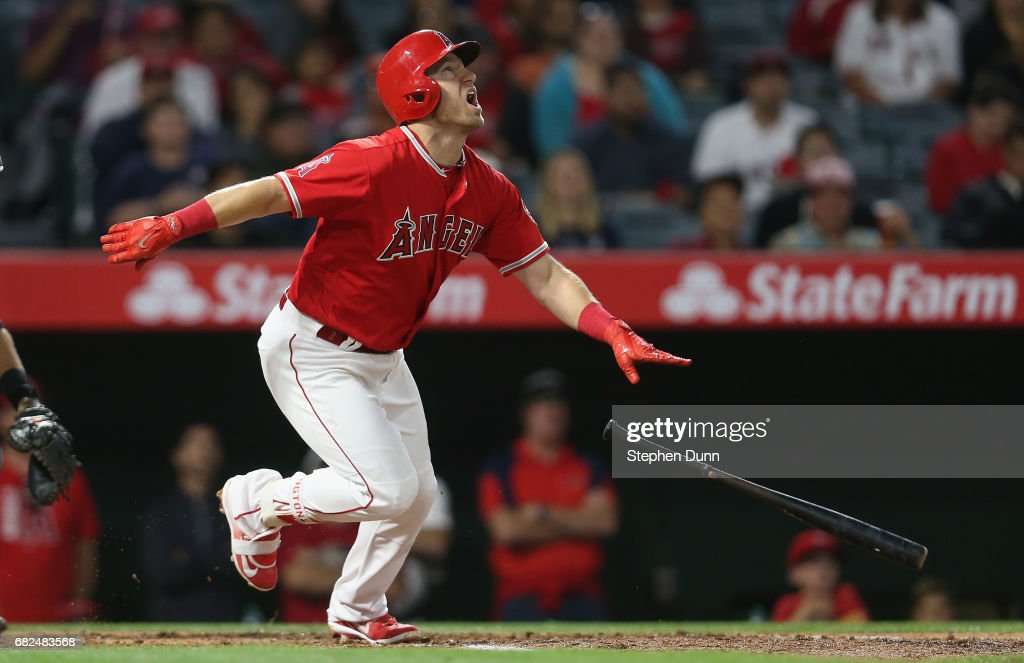 Cliff Pennington #7 of the Los Angeles Angels of Anaheim watches his batted ball bounce high as it goes for an infield single and an RBI in the second inning against the Detroit Tigers at Angel Stadium of Anaheim on May 12, 2017 in Anaheim, California.