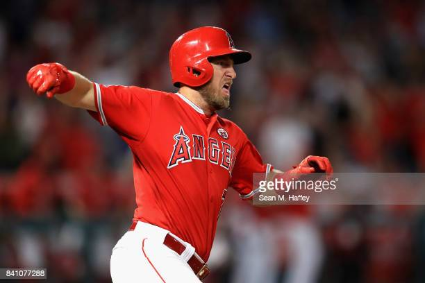 Cliff Pennington of the Los Angeles Angels runs to first base after hitting a grand slam homerun during the seventh inning of a game against the...