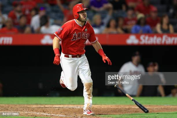 Cliff Pennington of the Los Angeles Angels runs to first base after hitting a grandslam homerun during the seventh inning of a game against the...