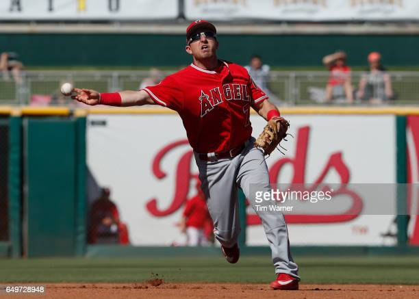 Cliff Pennington of the Los Angeles Angels throws to first in the fourth inning against the Cincinnati Reds during the spring training game at...