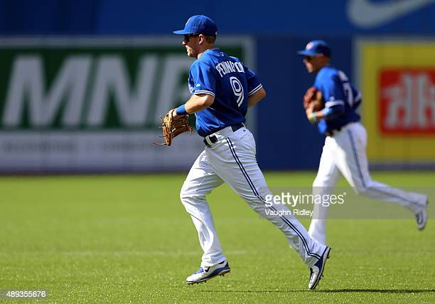 Cliff Pennington of the Toronto Blue Jays leaves the field at the end of the fifth inning during a MLB game against the Boston Red Sox at Rogers...