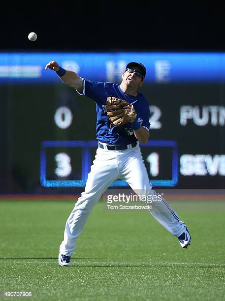 Cliff Pennington of the Toronto Blue Jays makes a throwing error in the eighth inning during MLB game action against the Tampa Bay Rays on September...