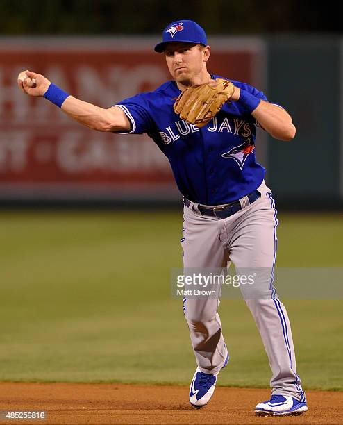 Cliff Pennington of the Toronto Blue Jays throws during the game against the Los Angeles Angels of Anaheim at Angel Stadium of Anaheim on August 21...