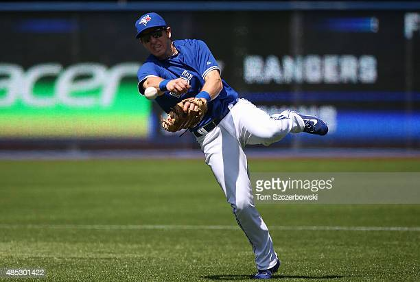 Cliff Pennington of the Toronto Blue Jays throws out the baserunner in the first inning during MLB game action against the Oakland Athletics on...