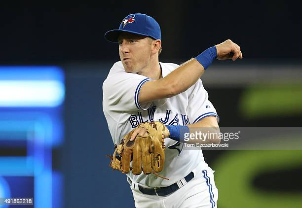 Cliff Pennington of the Toronto Blue Jays throws out the baserunner in the eighth inning during MLB game action against the New York Yankees on...