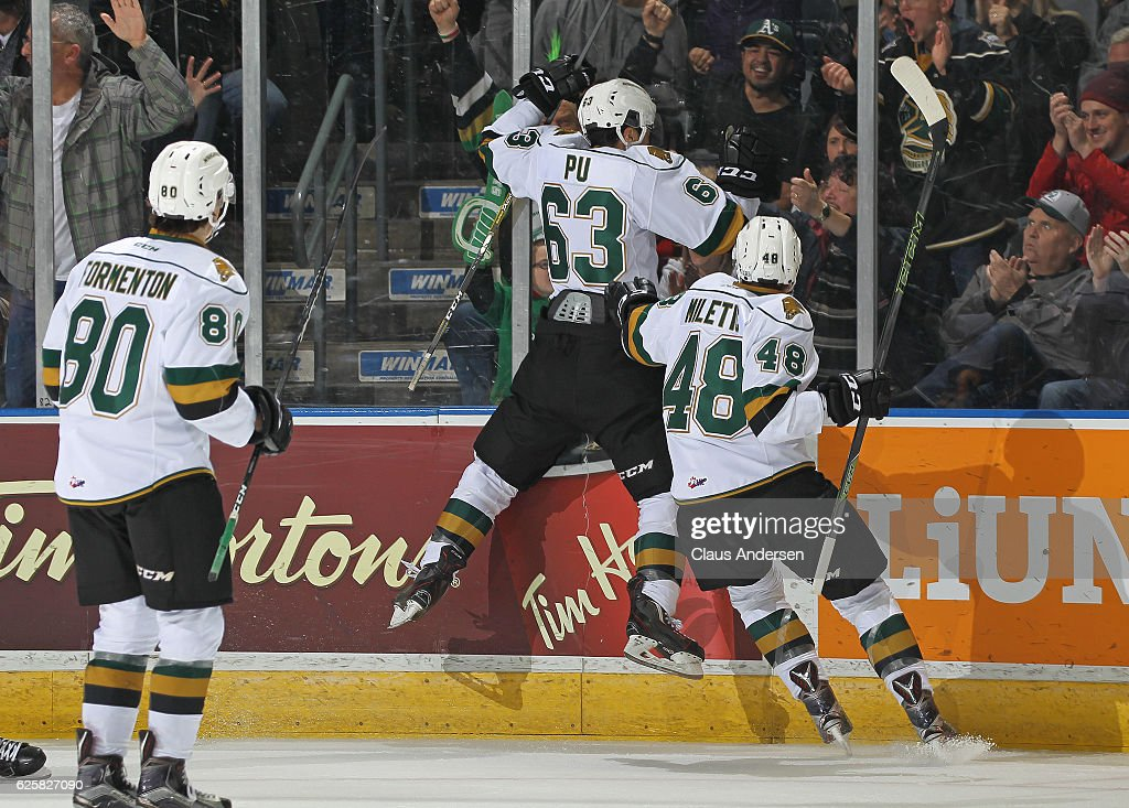 Cliff Pu #63 of the London Knights celebrates a goal against the Barrie Colts during an OHL game at Budweiser Gardens on November 25, 2016 in London, Ontario, Canada. The Knights defeated the Colts 4-1.