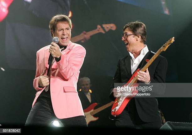 Cliff Richard and Hank Marvin of The Shadows performing on stage during their last concert at Wembley Arena in London on the 23rd October 2009