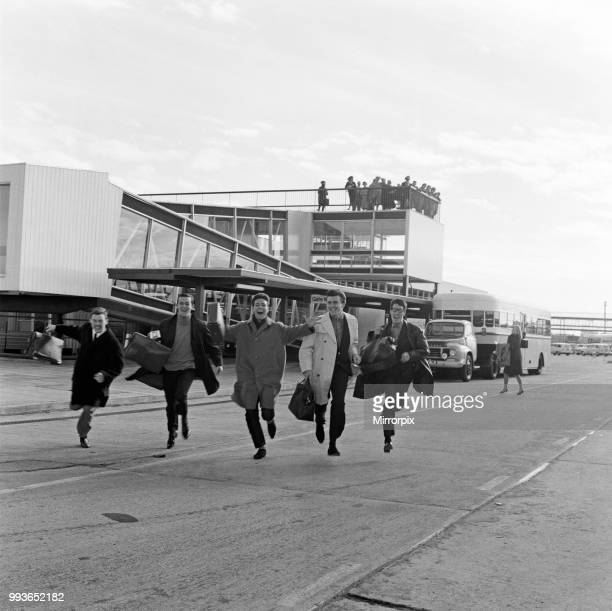 Cliff Richard and the Shadows at London Airport. Pictured running across the tarmac as they are late for their plane to America, 30th October 1962.