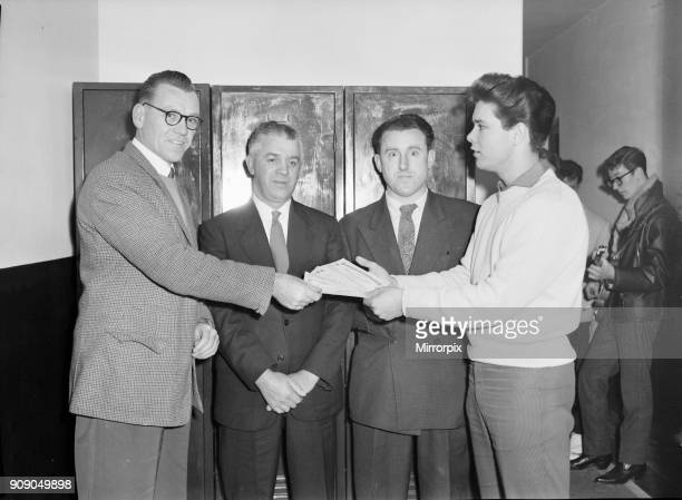 Cliff Richard and The Shadows backstage at The Regal, Cambridge 10th November 1959 Our picture shows Cliff Richard presenting a cheque.