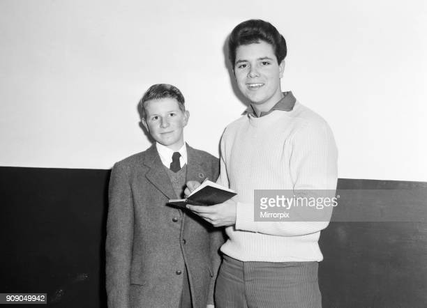 Cliff Richard and The Shadows backstage at The Regal, Cambridge 10th November 1959. Cliff signing a young autograph hunters book.