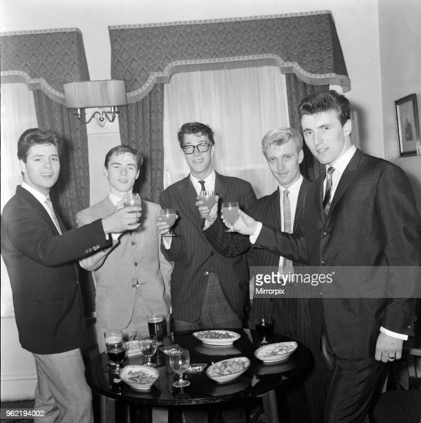 Cliff Richard and The Shadows, left to right, Cliff Richard, Tony Meehan, Hank B Marvin, Jet Harris and Bruce Welsh. They are drinking a toast of...