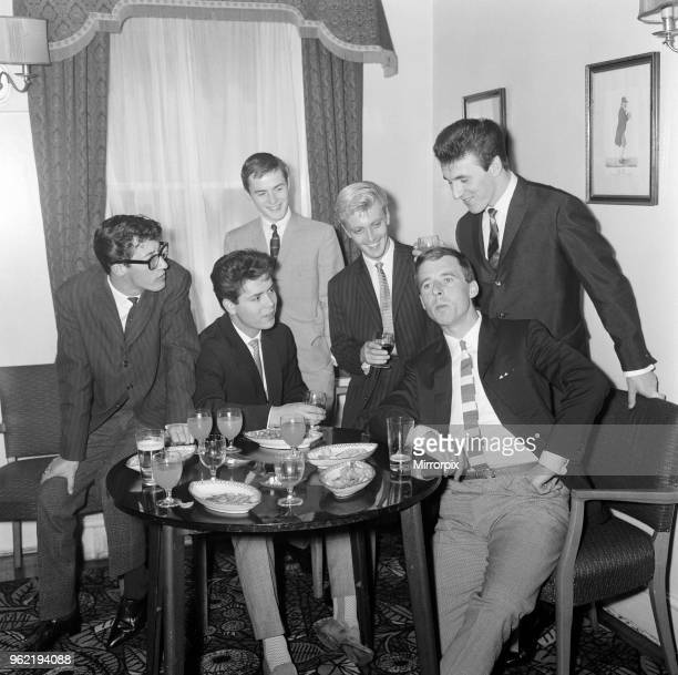 Cliff Richard and The Shadows left to right Hank B Marvin Cliff Richard Tony Meehan Jet Harris Jerry Lordan and Bruce Welsh They are drinking a toast...