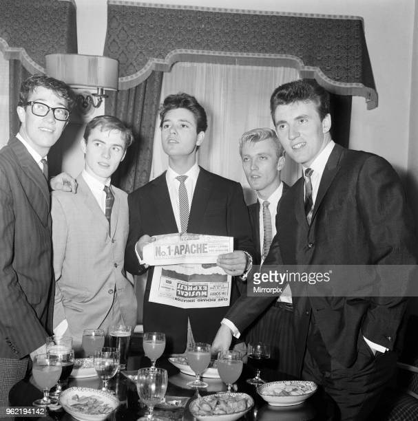 Cliff Richard and The Shadows, left to right, Hank B Marvin, Tony Meehan, Cliff Richard, Jet Harris and Bruce Welsh. They are drinking a toast of...