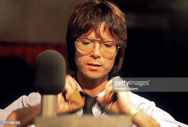 Cliff Richard at work in a recording studio London 1980