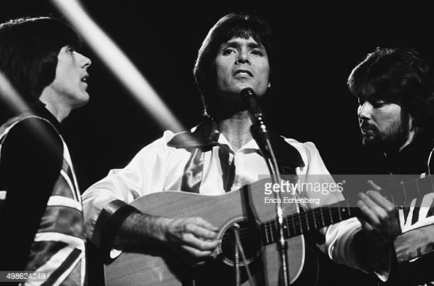 Cliff Richard performs on stage at the Royal Albert Hall London December 1976