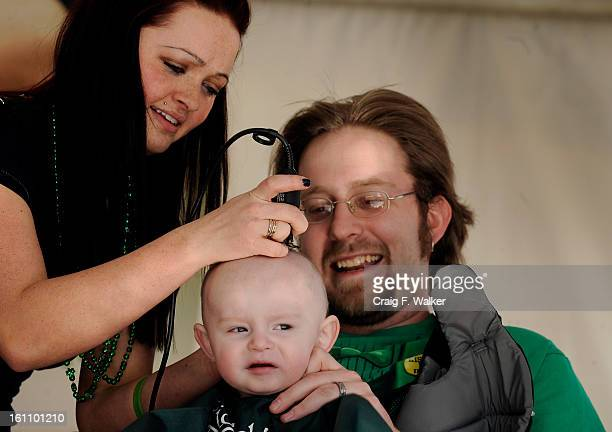 031210_HEADSHAVING_CFW Cliff Rivare comforts his son Freddie as Alexa Hartley shaves the childs head Over 250 men women and children were expected to...