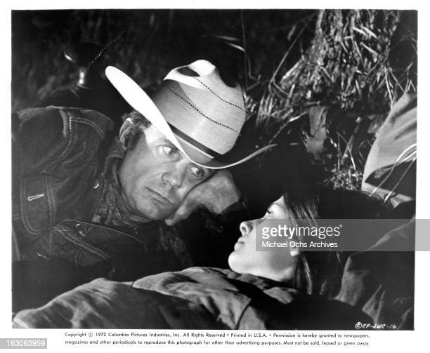Cliff Robertson lies with Cristina Ferrare in a scene from the film 'JW Coop' 1971